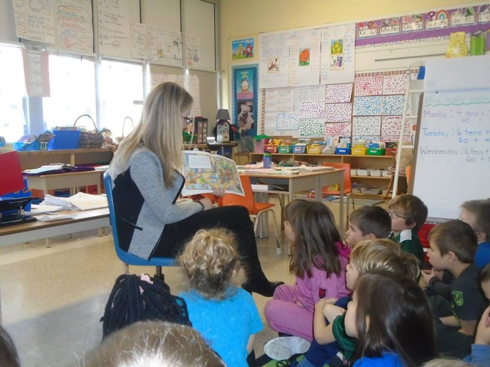 Amy reading to a class at St. Bernadette Elementary School